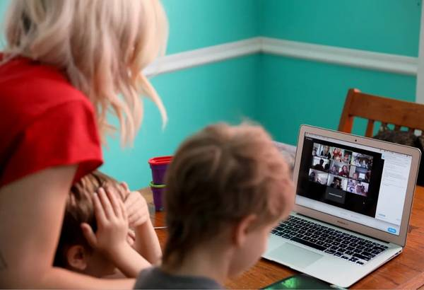 Mom helping kids with online learning